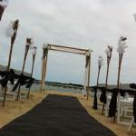 bamboo fire lanterns beach wedding