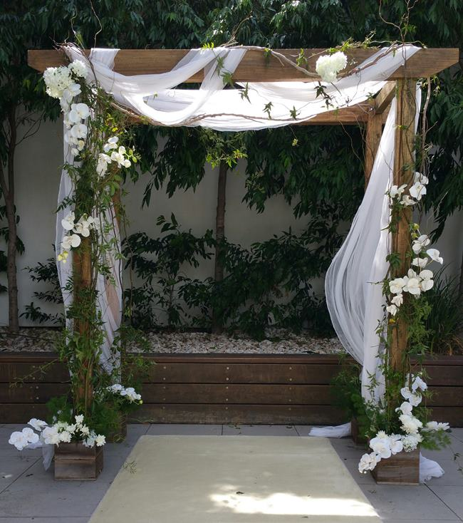 Timber wedding arch hire
