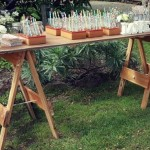 Rustic wooden trestle table drink station