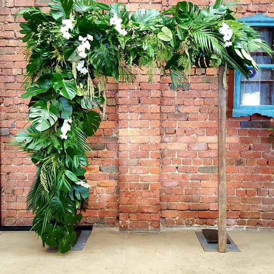 Monstera leaf wedding arch