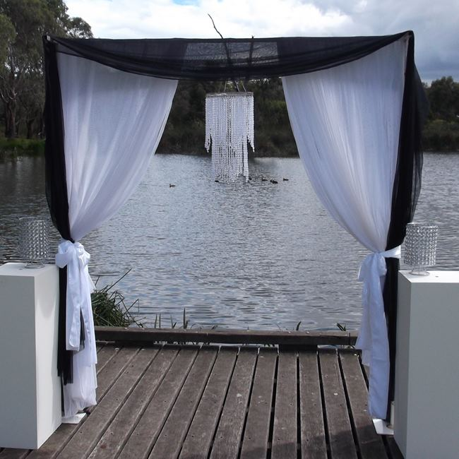 Black and white wedding arbour