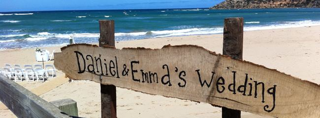 wedding sign on the beach