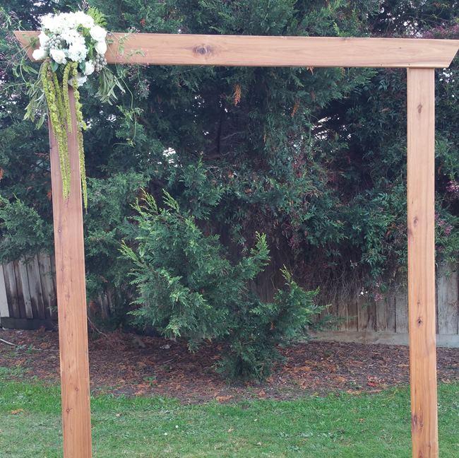 Rustic timber wedding arbour