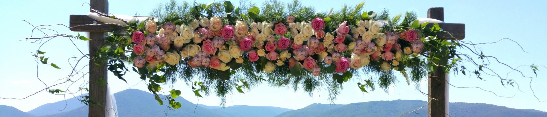 pink wedding arbour flowers