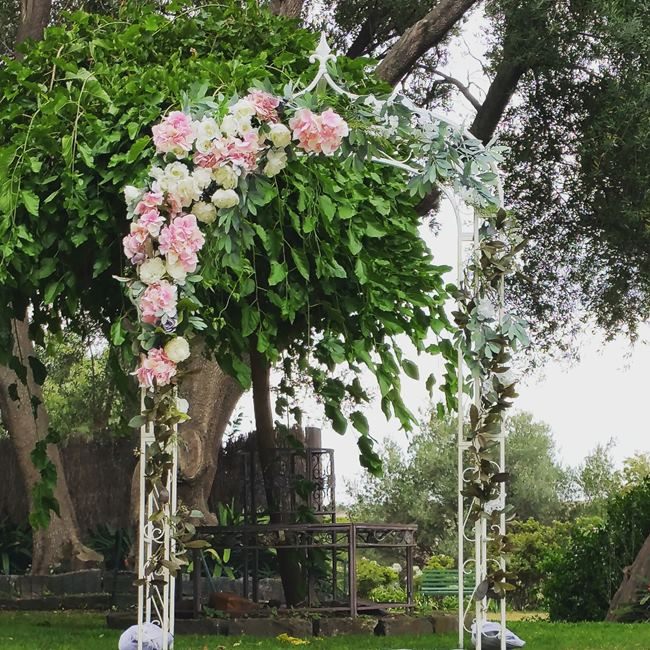 Wedding arch with pink flowers