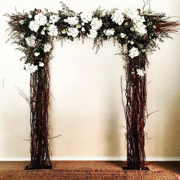 Curly willow wedding arch