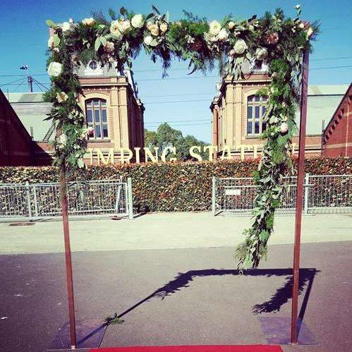 rose gold wedding arbor