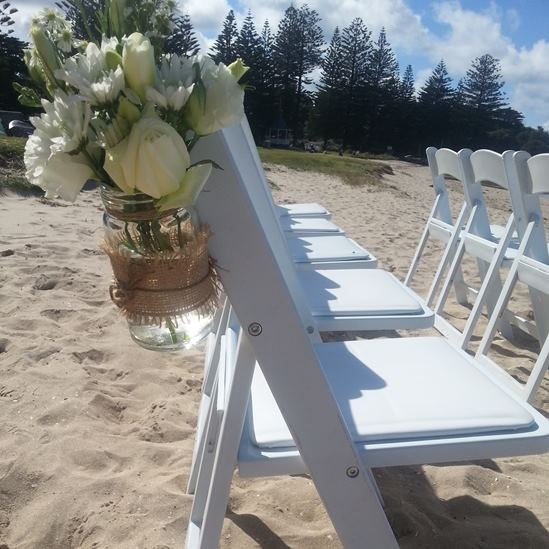 wedding aisle chair with jar of flowers