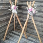 bamboo tripods with pink flowers