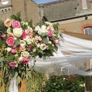 wooden arch with pink flowers