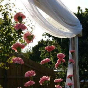 wooden Wedding arch with pink flowers