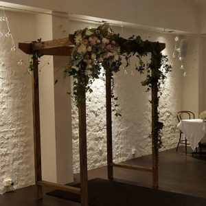 Rustic wooden arch with Ivy