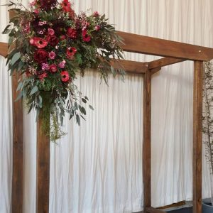 Rustic wooden wedding arch