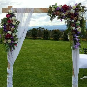 wooden arbour with purple flowers