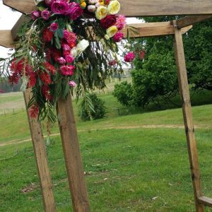 bare wooden wedding arches