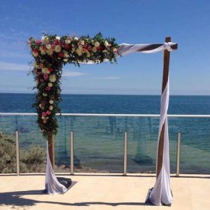 Fresh flowers at a beach wedding