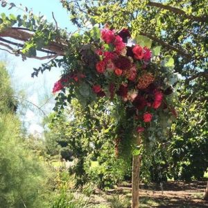 Wedding arch with fresh red flowers